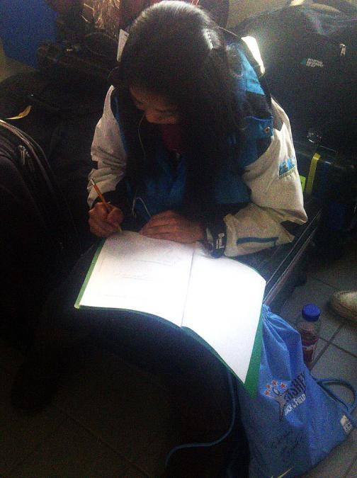 Angeline busy doing homework